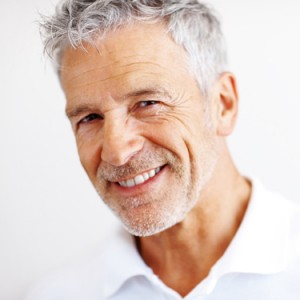 Closeup portrait of a casual mature business man on white background